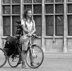 antwerpen (gerben more) Tags: street holiday window monochrome bike bicycle dreadlocks blackwhite cyclist belgium streetscene tourist cycle youngman antwerpen handsomeman