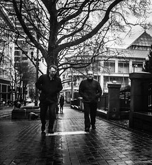 On Streets Well Traversed (TMimages PDX) Tags: road street city people urban blackandwhite monochrome buildings portland geotagged photography photo image streetphotography streetscene sidewalk photograph pedestrians pacificnorthwest avenue vignette fineartphotography iphoneography