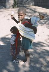 Namibia 2002 (patrikmloeff) Tags: world voyage africa travel 2002 baby holiday girl kids analog vacances reisen holidays minolta outdoor earth african kinder kind adventure afrika analogue traveling monde namibia fille ferien mdchen reise afrique welt erde namibian southernafrica barfuss abenteuer barfoot afrikanisch tragtuch sdlichesafrika africanwinter afrikanischerwinter