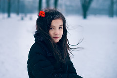 At the fingertips of a blizzard (isabelroeder) Tags: winter red portrait snow cold girl beautiful beauty rose 50mm nikon photographer wind snowstorm windy portraiture blizzard d610 nikkor50mm14 blizzard2016