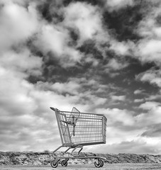 Shopping III (autobahn66.com) Tags: sky blackandwhite clouds surrealism fineart surreal shoppingcart discarded consuming criticism