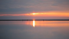 Sunset walk (cathbooton) Tags: sunset red sun lake reflection water canon outdoors still path walk walkers marinelake wirral westkirby merseyside