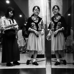 Singapore (ale neri) Tags: street people blackandwhite bw reflection subway asian hands singapore metro streetphotography aleneri alessandroneri