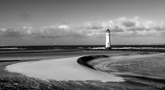 everything moves except for the lighthouse (lunaryuna) Tags: uk england sky bw panorama lighthouse beach monochrome weather coast blackwhite mood dune urbannature lunaryuna cloudscape survivor wallasey newbrighton merseyside wirralpeninsula ckouds perchrocklighthouse