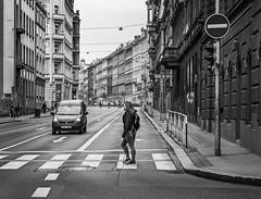Transgression (Doug Knisely) Tags: street car buildings crossing prague oldbuildings olympus crosswalk crossingstreet omdem5markii 4518woman