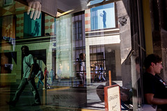 . (www.piotrowskipawel.pl) Tags: street city man reflection building window shop architecture reflections germany mnchen bayern cityscape hand streetphotography documentary manequine documentaryphotography colorstreetphotography pawepiotrowski piotrowskipawelpl