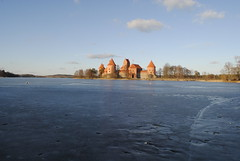 Castle (modestmoze) Tags: old bridge blue trees winter sky brown white lake castle history ice nature grass lines yellow architecture clouds outside outdoors island wooden day towers cracks pillars lithuania trakai 2016 500px