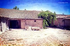 Corral 02 (rokobilbo) Tags: old roof sky stone barn adobe barnyard castilla
