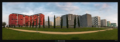 Painterly Neighbourhood (Ilan Shacham) Tags: trees red sky panorama grass modern buildings landscape spain colorful cityscape view pano fineart scenic flats vitoria fineartphotography vitoriagasteiz