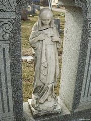 St. Joseph's Cemetery (Gabrielle Gaia) Tags: sculpture west cemetery grave graveyard statue illinois catholic tombstone il gravestone virginmary peoria stjosephscemetery catholiccemetery