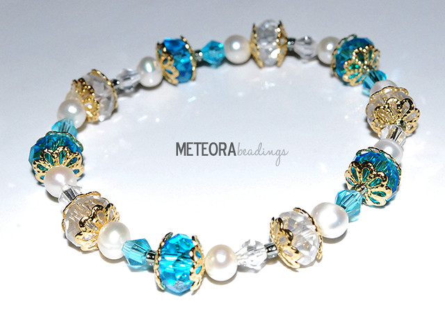 Bracelet - blue, clear and pearl-color beads, with gold-color bead caps