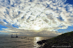 Fishermen emptying their nets (Johan Konz) Tags: winter sunset sea sky cloud white seascape netherlands clouds landscape fishing fishermen outdoor nets fishingboat dike waterland rubberboat ijmeer emptying seadike uitdammerdijk