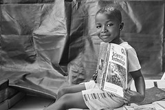 Bricilla (Andreas Jopp) Tags: africa blackwhite child kind afrika enfant learn voigtländer afrique ivorycoast abidjan schoolbook lernen elfenbeinküste apprendre schulbuch livrescolaire coted´ivoire