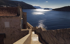 jets of sparks in fountains of blue (cherryspicks) Tags: travel blue sea sun sunlight house reflection building water wall architecture landscape island mediterranean ship outdoor croatia historic spark dubrovnik adriatic lokrum