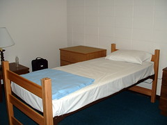 Bed. (dccradio) Tags: lamp minnesota wall bed room stpaul sheets pillow blanket frame northwestern saintpaul suitcase mn accommodations waterbottle dormroom nightstand radioconference inspo2004 skylightradionetwork hartillhall