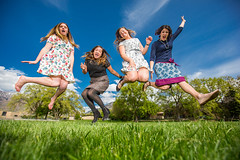 Happiness in a springtime leap (Flickr_Rick) Tags: woman girl sarah outside casey spring jump jumping roommates erin bluesky skirt greengrass jumpology lovetoleapthursday