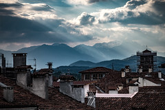 rooftops (AOP fotografia) Tags: street blue roof light red sky urban panorama cloud sun house mountain rooftop home colors composition landscape italia ray view terrace streetphotography fujifilm build distance vicenza veneto 55200 contrasto xt1