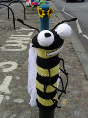 Knitted bee (Nekoglyph) Tags: road street black yellow insect cycling knitting wasp yorkshire bee knitted carpark cobbles striped bollard thirsk antennae yarnbombing tourdeyorkshire2016