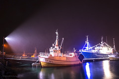 Norwegian fisherboats facing a blizzard in the night (lunaryuna) Tags: longexposure nightphotography winter snow norway night season coast nightlights harbour le colourful lunaryuna fisherboats nocturnalphotography northernnorway tromsfylke arcticregion blizzars arcticnight nordlenangen seasonalwonders lenangenstraumen