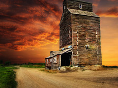 The elevator (mrbillt6) Tags: road wood old building grass clouds rural landscape elevator northdakota prairie plains