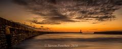 Harbour Sunrise (Steven Peachey) Tags: uk morning light england sky sun lighthouse beach clouds sunrise golden coast pier exposure wideangle fullframe seaham northeastcoast seahamharbour northeastengland ef1740mmf4l lee09gnd leefilters canon6d lee06gnd lightroom5 stevenpeachey