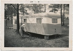 1961 Photo | Old woman & Her Trailer (steveartist) Tags: trees photos dresses trailers oldwomen bonnets antiquephoto mobilehomes traveltrailers scannedphotographs oldfashionedclothing scallopededgephotograph clothesantique