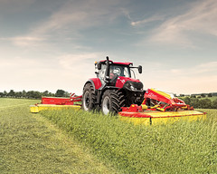 Case IH Optum CVX 300 with mower (Case IH Europe) Tags: blue sky panorama sun tractor field grass landscape europe afternoon flat outdoor farming machine case vehicle mower 300 hay agriculture silage tyres mowing cvx caseih largefield optum