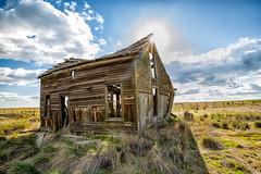Sun Kissed (KPortin) Tags: sun abandoned clouds fence abandonedhouse fields sunstar douglascounty