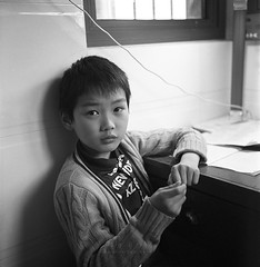 IMG3542fb1 () Tags: china street boy portrait people blackandwhite 120 6x6 tlr film rollei analog rolleiflex mediumformat blackwhite kid asia wuxi kodak bokeh trix snapshot squareformat bnw planar streetshot kodakfilm xtol carlzeiss trix400 rolleiflex35f carlzeisslenses kodakphoto nikonsupercoolscan9000ed planar7535 filmpohotography sanshot