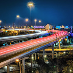 moving city to city (Sky Noir) Tags: road city travel blue red urban white night turn lights highway long exposure traffic rush hour commute interstate curve distance superhighway