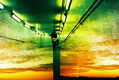 Lomo  caught in the middle (lomomowlem) Tags: sunset colour green film dark underground lomo lca xpro lomography doubleexposure vibrant crossprocess lofi analogue halfframe subterranean pedestriantunnel expiredfilm fluorescentlights kodakelitechrome ebx misaligned colourstreambrighton