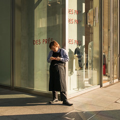 nihombashi-0439-ps-w (pw-pix) Tags: windows light signs man glass japan shop writing tokyo shadows phone apron paving dummy manequin nihombashi despres clothingshop lookingatphone