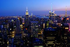 New York City at Sunset (` Toshio ') Tags: city newyorkcity sunset usa newyork skyline architecture america skyscraper buildings cityscape manhattan empirestatebuilding toshio xe2 fujixe2