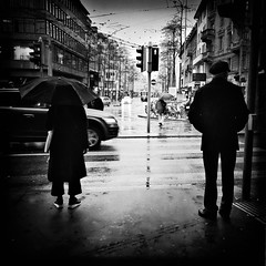 Rainy Zurich (Thomas Renken) Tags: blackandwhite bw monochrome switzerland blackwhite streetphotography zrich unposed twopeople urbanphotography streetcandid citysnap schwarzweis strassenfotografie