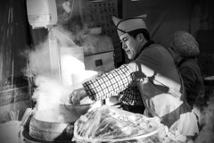 Street food in Haeundae (Sacule) Tags: street travel winter portrait people urban blackandwhite beach contrast canon asia cook steam busan worker southkorea fishpaste streetfood 2016 heundae 600d sigma1770