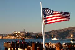 Alcatraz and US flag (theseBoetz) Tags: sanfrancisco california blue winter red sea sky people usa white tower boat flag ruin prison alcatraz flagpole starsandstripes