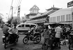 . (Out to Lunch) Tags: street urban blackandwhite monochrome architecture outdoors fuji market vietnam tay business saigon binh 223 cholon urbanite earthasia x100t