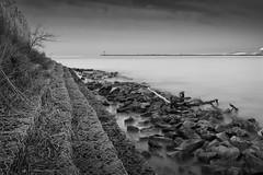 No Longer a Step (Thomas Pohlig) Tags: ocean longexposure sea blackandwhite water landscape canal newjersey rocks jetty fineart jersey series capemay jerseyshore seashore rockpile higbeebeach