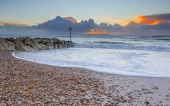Early Warning (nicklucas2) Tags: sea cloud seascape beach water rock sunrise seaside sand wave pebble isleofwight solent needles groyne cloudsstormssunsetssunrises
