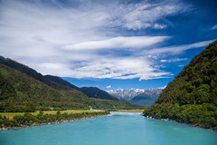 Milky blue glacial water of Whataroa River in New Zealand (Dmitri Naumov) Tags: blue newzealand wild summer sky terrain cloud sunlight nature water horizontal rural river season landscape outdoors photography coast rainforest whitewater day turquoise atmosphere sunny nobody nopeople shore nz ravine remote geology wilderness riverbank westcoast milky southernalps rapid ambience touristattraction scenics 2010 waterscape glacial mountainrange temperate goodweather meltwater traveldestinations colorimage beautyinnature southislandnewzealand whataroa nonurbanscene tropicalclimate