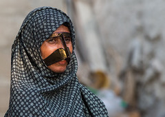 a bandari woman wearing a traditional mask called the burqa, Qeshm Island, Salakh, Iran (Eric Lafforgue) Tags: people woman horizontal outdoors persian clothing asia veil mask iran muslim islam religion hijab culture persia hidden covered iranian adults adultsonly oneperson traditionaldress burqa customs ethnicity middleeastern persiangulf sunni qeshmisland burka chador hormozgan onewomanonly burqua middleagedwoman 50sadult  waistup  1people  iro straitofhormuz  colourpicture  salakh borqe boregheh iran034i9549