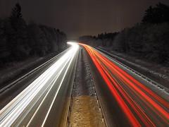 Speeding through winter (Jens Haggren) Tags: longexposure trees snow night lights motorway sweden olympus omd em1 nacka