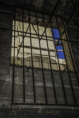 BLUE SKY (akahawkeyefan) Tags: blue sky church window grate bars cement fresno walls cornerstone davemeyer