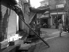 An alley Deoghar (Rajib Singha) Tags: street travel people bw india interestingness alley jharkhand deoghar flickriver canonpowershots90