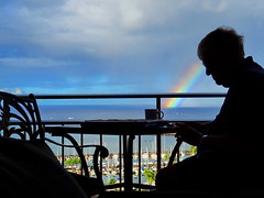 The reader (peggyhr) Tags: ocean man cup marina table hawaii rainbow chairs silhouettes backlit railing hff 25faves peggyhr redlevelno1 dsc01570a