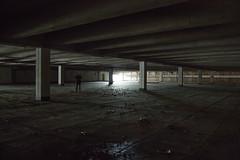 follow the light (guido.elting) Tags: light texture abandoned dark person licht parking fear pillar surreal struktur structure deck exit leafs bltter karstadt angst sulen ausgang parkdeck textur