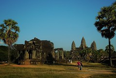 a stroll to remember (SM Tham) Tags: trees sky people grass stone buildings palms outdoors temple compound cambodia khmer library towers angkorwat unescoworldheritagesite walkway paths angkor grounds lontar lotusbud suryavarmanii mainapproach