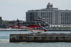 Oversized Dragonflies (lefeber) Tags: city nyc newyorkcity urban newyork architecture buildings dock downtown waterfront helicopters atlanticocean