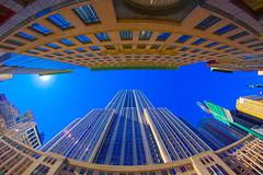 Empire State Building fisheye (Mirkwood Networks) Tags: nyc newyorkcity blue sky sun colors manhattan sunny fisheye midtown esb empirestatebuilding