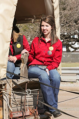 Riding The Wagon (wyojones) Tags: woman cute girl beautiful beauty smile shirt wagon pretty texas houston parade cowgirl brunette lovely bluejeans trailride houstonlivestockshowandrodeo wyojones houstonlivestockandrodeoparade